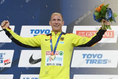 Gold medalist Arthur Abele reacts during the awarding ceremony of the Decathlon at the Athletics 2018 European Championships in Berlin, Germany, 10 August 2018.