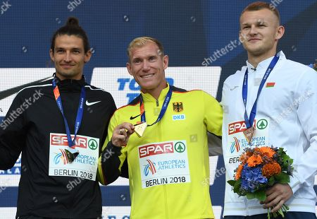 (L-R) Silver medalist Ilya Shkurenyov of Russia, gold medalist Arthur Abele of Germany and bronze medalist Vitali Zhuk of Belarus pose during the awarding ceremony of the Decathlon at the Athletics 2018 European Championships in Berlin, Germany, 10 August 2018.