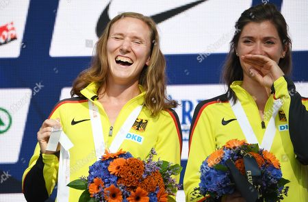 Stock Picture of Former German sprinters Fabienne Kohlmann (L) and Esther Cremer smile as they and the German women's 4x400m relay team receive the gold medal of the 2010 European Athletics Championships during an awarding ceremony at the Athletics 2018 European Championships in Berlin, Germany, 10 August 2018. The German relay were awarded as Russia, first placed in the race in 2010, have been stripped off their medals due doping rules violation.