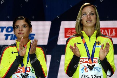 (L-R) silver medalist Pamela Dutkiewicz of Germany and bronze medalist Cindy Roleder of Germany celebrate during the medal ceremony for the Women's 100m Hurdles final at the Athletics 2018 European Championships in Berlin, Germany, 10 August 2018.