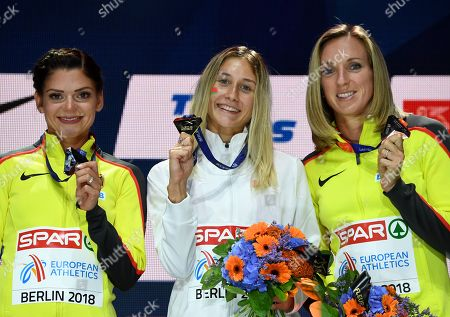 (L-R) silver medalist Pamela Dutkiewicz of Germany, Gold medalist Elvira Herman of Belarus and bronze medalist Cindy Roleder of Germany celebrate during the medal ceremony for the Women's 100m Hurdles final at the Athletics 2018 European Championships in Berlin, Germany, 10 August 2018.