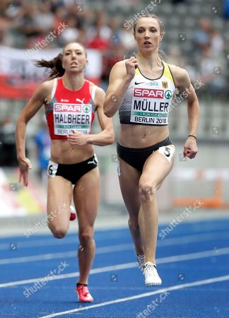 Stock Photo of Germany's Laura Mueller, right, and Switzerland's Cornelia Halbheer, left, compete during a women's 200 meter heat race at the European Athletics Championships in Berlin, Germany