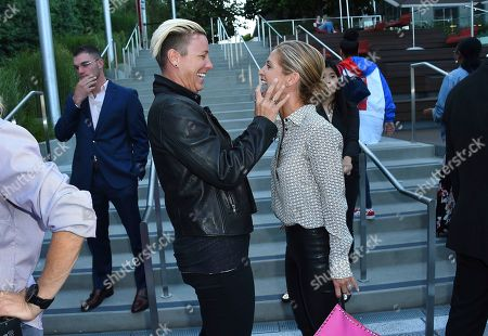 Abby Wambach, Glennon Doyle. Abby Wambach, center left, and Glennon Doyle arrive at the Hello Sunshine Video on Demand channel launch at NeueHouse Hollywood on in Los Angeles