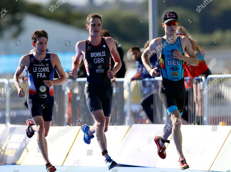From left, Pierre Le Corre of France, Alistair Brownlee of Great Britain, center, and Marten Van Riel of Belgium participate in the running discipline of the men's triathlon finals at Strathclyde Country Park during the European Championships in North Lanarkshire, Scotland
