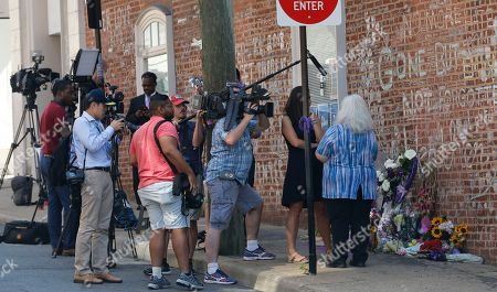 Susan Bro, mother of Heather Heyer who was killed during last year's Unite the Right rally, speaks with reporters at the spot where her daughter was killed in Charlottesville, Va., . The governor has declared a state of emergency in anticipation of the anniversary of the rally