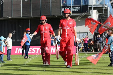 Lancashires Karl Brown & Lancashires Alex Davies during the Vitality T20 Blast North Group match between Lancashire Lightning and Birmingham Bears at the Emirates, Old Trafford, Manchester