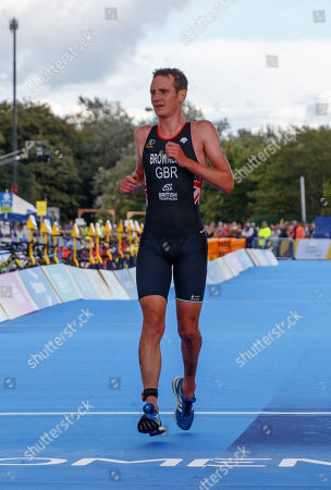 Alistair Brownlee of Great Britain crosses the line in 4th place in the Elite Men's Triathlon.
