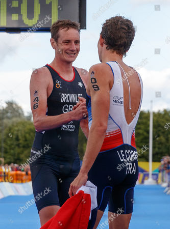 Alistair Brownlee of Great Britain congratulates gold medal winner Pierre Le Corre of France after Brownlee finished in 4th place in the Elite Men's Triathlon.