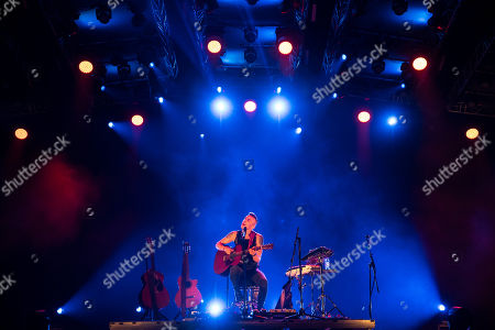 Stock Photo of Israeli singer-songwriter Asaf Avidan performs during his concert concert on the third day of the 26th Sziget (Island) Festival on Shipyard Island, Northern Budapest, Hungary, 10 August 2018. The Sziget Festival is one of the biggest cultural events of Europe offering art exhibitions, theatrical and circus performances and above all music concerts.