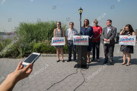 New York City Public Advocate Letitia James, center, speaks during a news conference, in New York. James will face off against Leecia Eve, an attorney who was an aide to Hillary Clinton and Cuomo, Zephyr Teachout, a professor at Fordham Law School, and congressman Sean Patrick Maloney in the Democratic primary race for attorney general