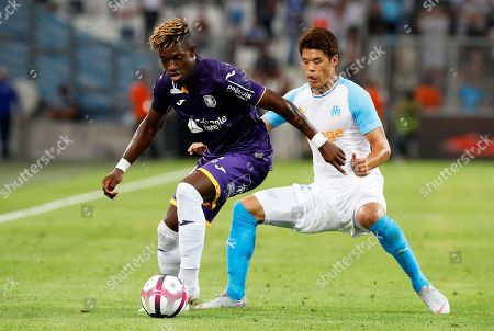 Hiroki Sakai (R) of Olympique Marseille in action against Francois Moubandje (L) of Toulouse during the French Ligue 1 soccer match between Olympique Marseille and Toulouse FC at the Velodrome Stadium in Marseille, southern France, 10 August 2018.
