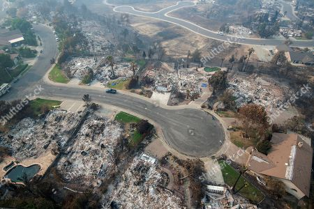 Ashen remains of homes are seen from an areal photo at the end of a Cul-de-sac in the Keswick neighborhood of Redding, Calif., . Fire crews have made progress against the biggest blaze in California history but officials say the fire won't be fully contained until September