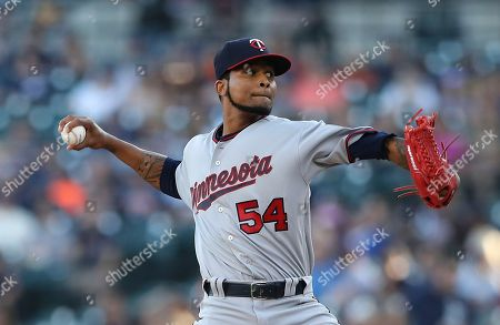 Minnesota Twins starting pitcher Ervin Santana throws during the first inning of a baseball game against the Detroit Tigers, in Detroit
