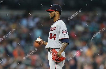 Minnesota Twins starting pitcher Ervin Santana stands on the mound after giving up a two-run home run to Detroit Tigers' Jose Iglesias during the fifth inning of a baseball game, in Detroit