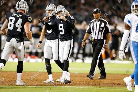 Oakland Raiders kicker Eddy Pineiro (9) celebrates with Paul Butler (84) and Johnny Townsend after kicking a field goal against the Detroit Lions during the first half of an NFL preseason football game in Oakland, Calif