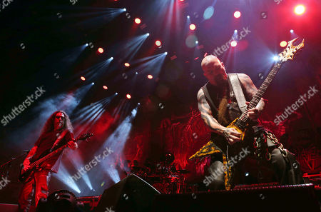 Kerry King, Tom Araya, Paul Bostaph, Gary Holt. Kerry King, Tom Araya, Paul Bostaph and Gary Holt with Slayer performs as the opener for Slayer at Cellairis Amphitheatre at Lakewood, in Atlanta