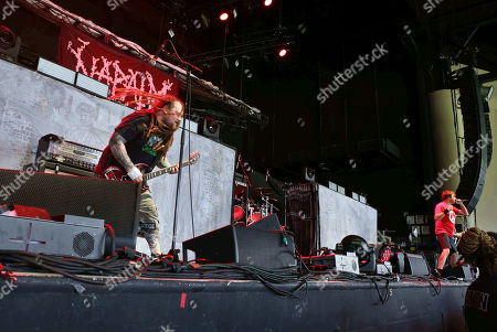 Shane Embury, Mark Greenway, Mitch Harris, Danny Herrera. Shane Embury, Mark Greenway, Mitch Harris and Danny Herrera with Napalm Death performs as the opener for Slayer at Cellairis Amphitheatre at Lakewood, in Atlanta