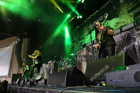 Eric Peterson, Chuck Billy, Alex Skolnick, Gene Hoglan, Steve Di Giorgio. Eric Peterson, Chuck Billy, Alex Skolnick, Gene Hoglan and Steve Di Giorgio with Testament performs as the opener for Slayer at Cellairis Amphitheatre at Lakewood, in Atlanta