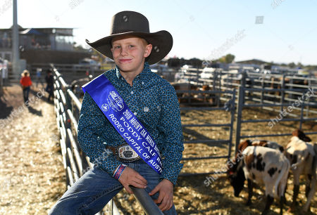 Stock Picture of Ten year-old Riley Schmidt poses for a photo after winning the Poddy Calf Ride final event at the Mount Isa Mines Rotary Rodeo, Queensland, Australia, 11 August 2018. This is the 60th anniversary of the rodeo, the biggest of its kind in the Southern Hemisphere.