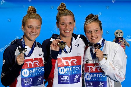 Alicia Blagg of Great Britain (L), Grace Reid of Great Britain (C) Tina Punzel of Germany (R) poses for photographs after winning a Silver, Gold and Bronze medals respectively in the 3 metre Springboard Women's Final at the Glasgow 2018 European Diving Championships, Glasgow, Britain, 11 August 2018.
