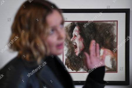 A painting of the late Australian actor Heath Ledger is seen behind Australian actor Abbie Cornish speaking during a media preview of the 'Heath Ledger: A Life In Pictures' exhibition at the National Film and Sound Archive of Australia (NFSA) in Canberra, Australian Capital Territory, Australia, 10 August 2018 (issued 11 August 2018). The free exhibition celebrates the life and work of one of Australia's most acclaimed actors, and will run in Canberra from 10 August 2018 until 10 February 2019.