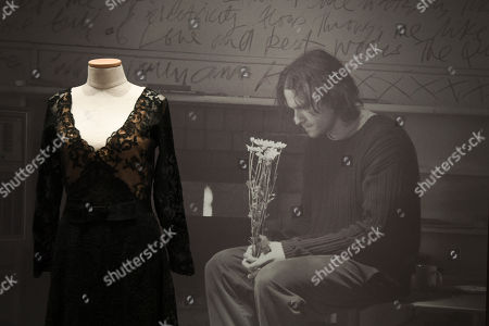 A portrait of the late Australian actor Heath Ledger is seen next to a costume from the film 'Candy' during a media preview of the 'Heath Ledger: A Life In Pictures' exhibition at the National Film and Sound Archive of Australia (NFSA) in Canberra, Australian Capital Territory, Australia, 10 August 2018 (issued 11 August 2018). The free exhibition celebrates the life and work of one of Australia's most acclaimed actors, and will run in Canberra from 10 August 2018 until 10 February 2019.