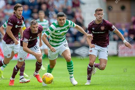 Tom Rogic(#18) of Celtic FC breaks away from Aaron Hughes(#16) of Heart of Midlothian and Oliver Bozanic(#7) of Heart of Midlothian during the Ladbrokes Scottish Premiership match between Heart of Midlothian and Celtic at Tynecastle Stadium, Edinburgh