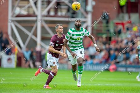Aaron Hughes(#16) of Heart of Midlothian and Odsonne Edouard(#22) of Celtic FC during the Ladbrokes Scottish Premiership match between Heart of Midlothian and Celtic at Tynecastle Stadium, Edinburgh