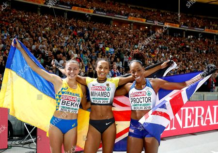 Winner Malaika Mihambo of Germany (C) celebrates with second placed Maryna Beck of Ukraine (L) and third placed Shara Proctor of Britain (R) after the Women's Long Jump final at the Athletics 2018 European Championships, Berlin, Germany, 11 August 2018.