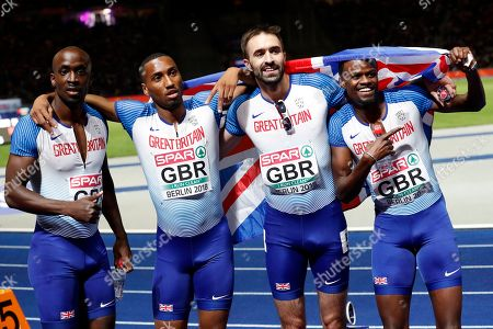 Stock Photo of British runners (from left) Dwayne Cowan, Matthew Hudson-Smith, Martyn Rooney and Rabah Yousif celebate after placing 2nd in the men's 4x400m Relay at the Athletics 2018 European Championships in Berlin, Germany, 11 August 2018.