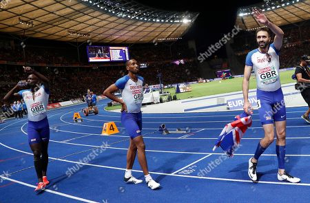 British runners (from left) Dwayne Cowan, Matthew Hudson-Smith and Martyn Rooney celebate after placing 2nd in the men's 4x400m Relay at the Athletics 2018 European Championships in Berlin, Germany, 11 August 2018.