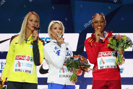 Stock Photo of (L-R) Silver medalist Kristin Gierisch of Germany, gold medalist Paraskevi Papahristou of Greece, and bronze medalist Ana Peleteiro of Spain pose for photographers during the medal ceremony for the women's Triple Jump final of the Athletics 2018 European Championships in Berlin, Germany, 11 August 2018.