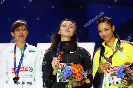 (L-R) Silver medalist Mirela Demireva of Bulgaria, gold medalist Mariya Lasitskene of Russia, and bronze medalist Marie-Laurence Jungfleisch of Germany react during the medal ceremony for the women's High Jump final of the Athletics 2018 European Championships in Berlin, Germany, 11 August 2018.