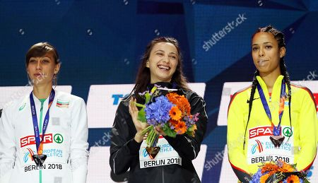 Stock Photo of (L-R) Silver medalist Mirela Demireva of Bulgaria, gold medalist Mariya Lasitskene of Russia, and bronze medalist Marie-Laurence Jungfleisch of Germany react during the medal ceremony for the women's High Jump final of the Athletics 2018 European Championships in Berlin, Germany, 11 August 2018.