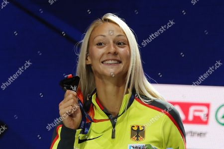 Stock Picture of Silver medalist Kristin Gierisch of Germany celebrates during the medal ceremony for the Triple Jump Women of the Athletics 2018 European Championships in Berlin, Germany, 11 August 2018.