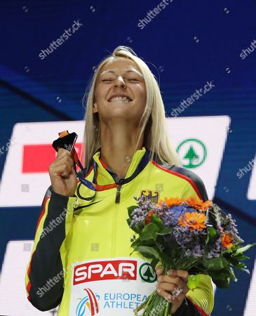 Silver medalist Kristin Gierisch of Germany celebrates during the medal ceremony for the Triple Jump Women of the Athletics 2018 European Championships in Berlin, Germany, 11 August 2018.
