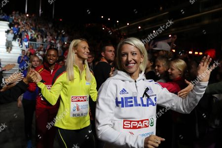 (L-R) Bronze medalist Ana Peleteiro of Spain, Silver medalist Kristin Gierisch of Germany, Gold medalist Paraskevi Papahristou of Greece celebrate during the medal ceremony for the Triple Jump Women of the Athletics 2018 European Championships in Berlin, Germany, 11 August 2018.