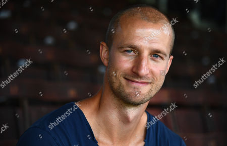 Former Fulham player Brede Hangeland poses for a photo ahead of kick off