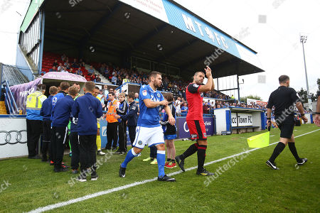 Macclesfield's Jared Hodgkiss and Grimsby's John Welsh lead out their sides