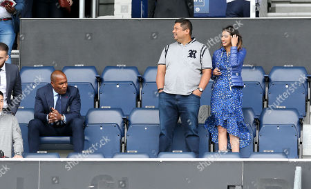 Ruben Emir Gnanalingam - QPR owner & wife Shirieene Hajamaideen  & QPR Director of Football Les Ferdinand  (L)