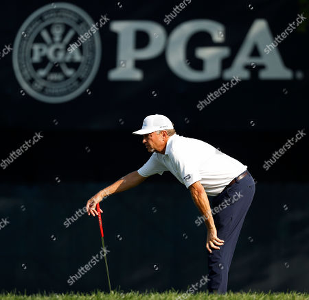 Davis Love III looks at a putt on the 18th green during the second round of the PGA Championship golf tournament at Bellerive Country Club, in St. Louis