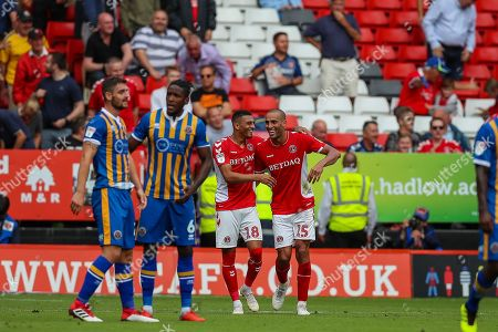 Goalscorer Charlton Athletic forward Karlan Ahearne-Grant (18) celebrates with teammate midfielder Darren Pratley (15) taking the score to 2-1 to Charlton during the EFL Sky Bet League 1 match between Charlton Athletic and Shrewsbury Town at The Valley, London