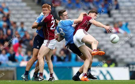 Stock Image of Dublin vs Galway. Dublin's James McCarthy and Brian Fenton with Ciaran Duggan and Thomas Flynn of Galway