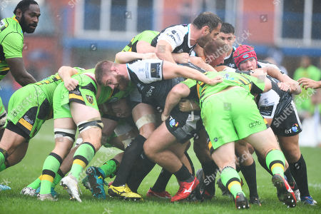 Rhodri Jones pictured in a ruck as the Ospreys move forward.