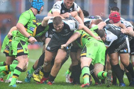 Rhodri Jones breaks away from a maul as the Ospreys move forward.