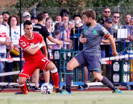 Stuttgart's Erik Tommy (L) in action against Real Sociedad's Asier Illarramendi (R) during the friendly test soccer match between VfB Stuttgart and Real Sociedad San Sebastian in Weinstadt near Stuttgart, Germany, 11 August 2018.