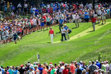 Rickie Fowler of the US, Charl Schwartzel of South Africa , and Dustin Johnson of the US walk off the second tee during the third round of the 100th PGA Championship golf tournament at Bellerive Country Club in St. Louis, Missouri, USA, 11 August 2018.