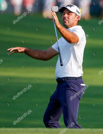 Charl Schwartzel of South Africa reacts at the eighteenth green during the third round of the 100th PGA Championship golf tournament at Bellerive Country Club in St. Louis, Missouri, USA, 11 August 2018.