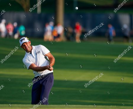 Charl Schwartzel of South Africa chips onto the eighteenth green during the third round of the 100th PGA Championship golf tournament at Bellerive Country Club in St. Louis, Missouri, USA, 11 August 2018.