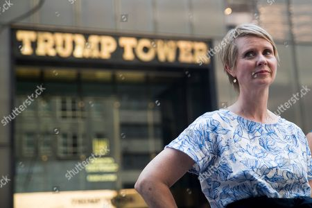 Democratic candidate for governor Cynthia Nixon stands outside Trump Tower before holding a news conference with New York State Attorney General candidate Zephyr Teachout, in New York. Nixon and Teachout endorsed each other